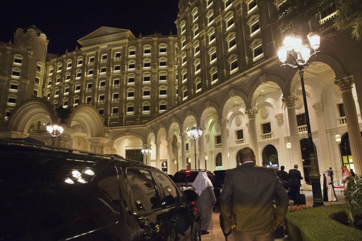 FILE - In this Jan. 23, 2016 file photo, the motorcade carrying then U.S. Secretary of State John Kerry arrives at the Ritz Carlton Hotel in Riyadh, Saudi Arabia. Princes and dozens of business moguls were detained in the hotel in early November 2017 where they were questioned and probed about their financial dealings. The unprecedented anti-corruption campaign exposed a new hierarchy in the kingdom and brought into sharp focus just how little power even the wealthiest royals wield in the face of the country's young potentate-in-waiting, Crown Prince Mohammed bin Salman. (AP Photo/Jacquelyn Martin, Pool, File)