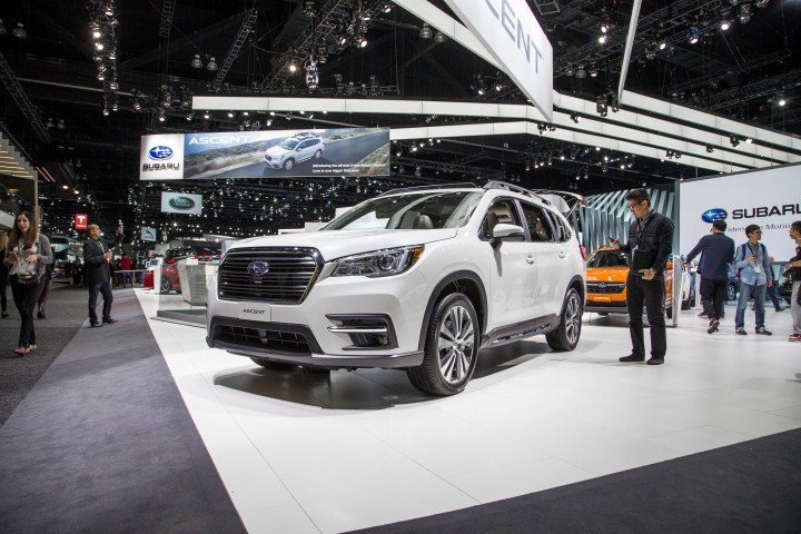 This photo provided by Edmunds shows Subaru's booth at the 2017 Los Angeles Auto Show. Shoppers can use such shows as a one-stop fact-finding mission for their next car purchase. They can ask questions of the experts at the displays, get hands-on exploring the vehicles, and sometimes even take a test drive. (Kurt Niebuhr/Courtesy of Edmunds via AP)