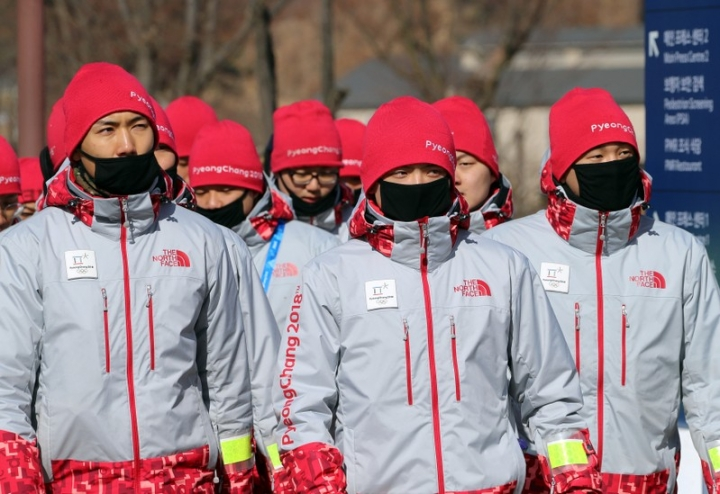 Volunteers protect their faces from the cold at the Olympic stadium of the Pyeongchang Winter Olympic Games in Pyeongchang, South Korea February 7, 2018.     REUTERS/Eric Gaillard