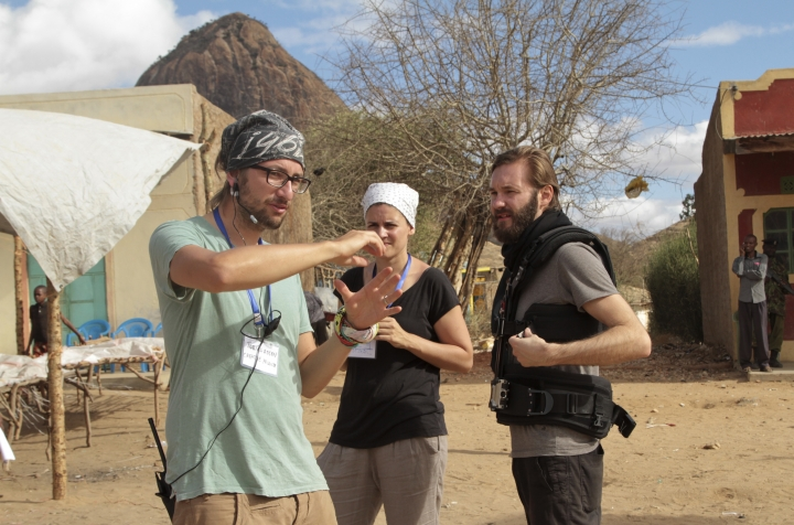 """In this photo taken Wednesday, Aug. 17, 2016, producer Tobias Rosen, left, director Katja Benrath, center, and cinematographer Felix Striegel discuss on location during the filming of the short film """"Watu Wote"""", meaning """"All of Us"""" in Swahili, in Ngomeni, Kenya. The true story of an al-Shabab extremist attack on a bus in Kenya just before Christmas in 2015 inspired the short film, that is in the running for an Academy Award on March 4. (Eric Mwangi/Hamburg Media School via AP)"""