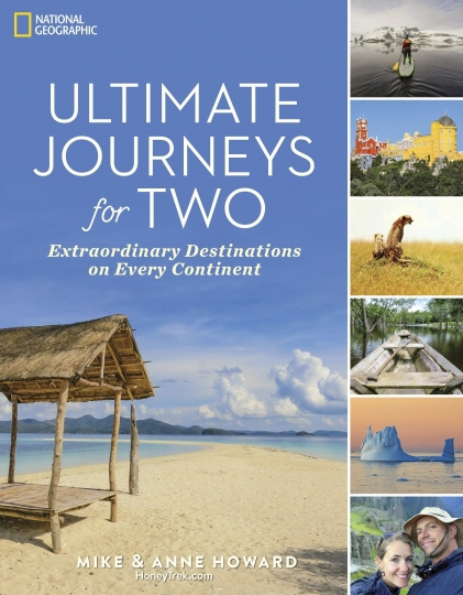 "This undated image shows the cover to ""Ultimate Journeys for Two: Extraordinary Destinations on Every Continent."" The book by Mike and Anne Howard grew out of their five-year adventure across seven continents as ""the world's longest honeymooners,"" an experience they chronicled on their blog HoneyTrek.com. (National Geographic via AP)"