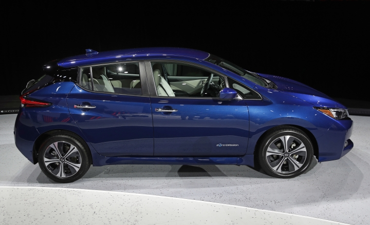 FILE - In this Tuesday, Sept. 5, 2017, file photo, the 2018 Nissan Leaf is on display during an unveiling event in Las Vegas. Electric car prices are falling, but they still cost more than equivalent gas models because of their expensive batteries. (AP Photo/John Locher, File)