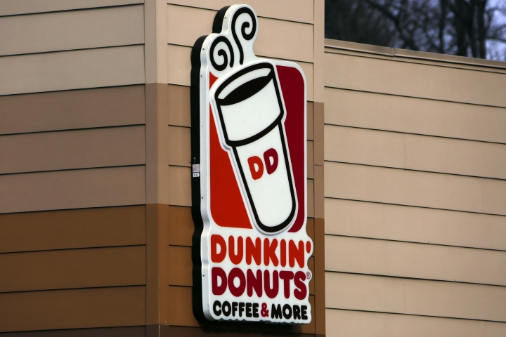 FILE- This Jan. 22, 2018, file photo shows a Dunkin' Donuts sign on a shop in Mount Lebanon, Pa. Dunkin' Donuts said Wednesday, Feb. 7, 2018, that the polystyrene foam cups will be completely phased out from all its stores globally by 2020. (AP Photo/Gene J. Puskar, File)