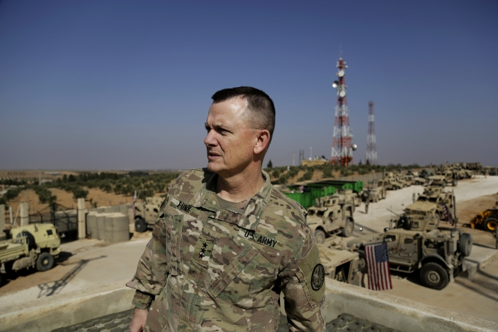 U.S. Army Lt. Gen. Paul E. Funk speaks to the Associated Press at an American outpost in the northern Kurdish town of Manbij, Syria, Wednesday, Feb. 7, 2018. The top U.S. general in the coalition fighting the Islamic State group pledged American troops would remain in the town despite Ankara's demands for a U.S. pullout. Turkey launched an offensive last month to drive Syrian Kurdish militiamen out of the enclave of Afrin and has threatened to extend its operation to Manbij. (AP Photo/Susannah George)