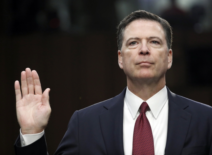 "FILe - In this June 8, 2017 file photo, former FBI Director James Comey is sworn in during a Senate Intelligence Committee hearing on Capitol Hill in Washington. Comey's publisher is moving up the release date of his memoir ""A Higher Loyalty,"" to April 17. (AP Photo/Alex Brandon, File)"