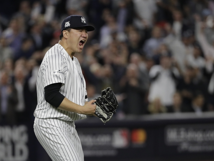 "FILE - In this Oct. 18, 2017, file photo, New York Yankees starting pitcher Masahiro Tanaka reacts after striking out Houston Astros' Josh Reddick in the fifth inning of Game 5 of baseball's American League Championship Series in New York. Tanaka went with his heart when deciding not to opt out of the final three seasons of his $155 million, seven-year contract signed in January 2014 with the New York Yankees. ""My thought was I want to go out and battle with these guys again,"" Tanaka said through a translator, Wednesday, Feb. 7, 2018. (AP Photo/David J. Phillip, File)"