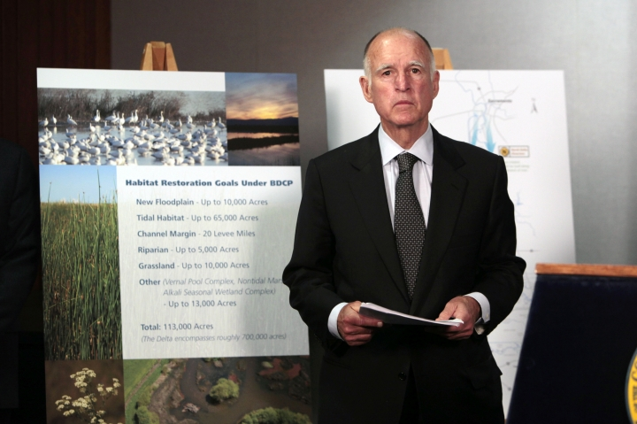 FILE - In this July 25, 2012 file photo, California Gov. Jerry Brown prepares to announce plans to build a giant twin tunnel system to move water from the Sacramento-San Joaquin River Delta to farmland and cities at a news conference in Sacramento. Brown is scaling back his troubled proposal for overhauling California's water system, at least for now. State official Karla Nemeth wrote Wednesday, Feb. 7, 2018, that the Brown administration is looking at building a single giant water tunnel now. (AP Photo/Rich Pedroncelli, File)