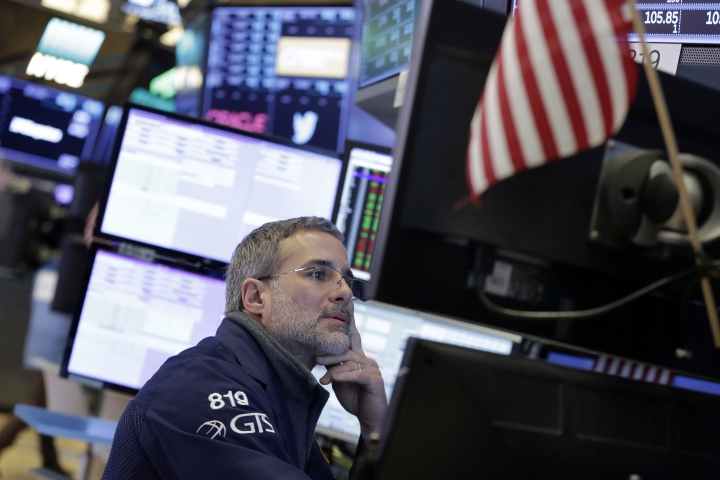 Specialist Anthony Rinaldi works at his post on the floor of the New York Stock Exchange, Wednesday, Feb. 7, 2018. Stocks are opening modestly higher on Wall Street as the market stabilizes following three days of tumult. (AP Photo/Richard Drew)