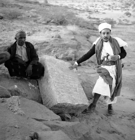 In this February 1957 file photo, two Yemenis stand near a column bearing ancient South Arabian script at the Awwam Temple, also known as the Mahram Bilqis in Marib, Yemen. Experts fear the temple, as well as other historic and cultural wonders across Yemen beyond those acknowledged by international authorities, remain at risk as the country's stalemated Saudi-led war against Shiite rebels rages on in 2018. (AP Photo/Leila Wynn, File)