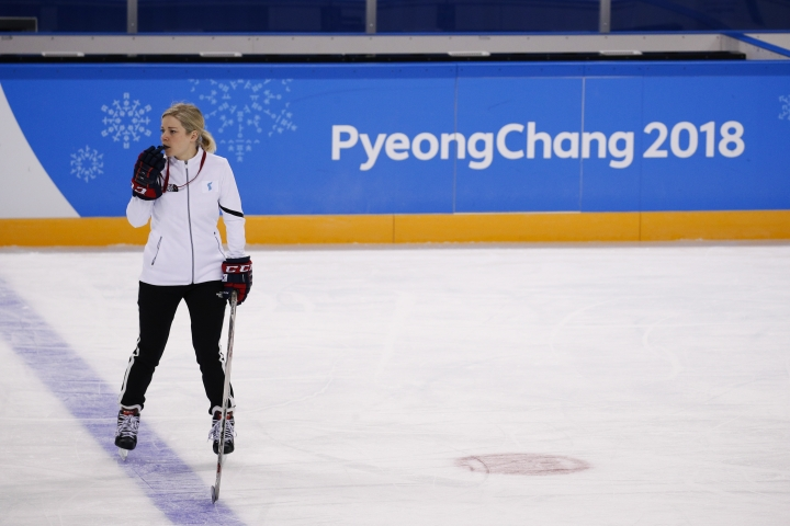FILE - In this Feb. 5, 2018 file photo, the joint Korean women's ice hockey team head coach Sarah Murray watches her players train prior to the 2018 Winter Olympics in Gangneung, South Korea. Murray said it's important for the players to march together in the opening ceremony to show they are unified. Asked if marching together is a political statement, Murray said putting the team together was a political statement, but now it's just one team. The team has played together just once before, but she says the chemistry is better than she could have imagined. Their first game is Saturday, Feb. 10 against Sweden. (AP Photo/Jae C. Hong, File)