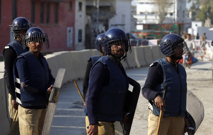 Pakistani police officers stand alert outside a central jail during a court proceeding regarding the lynching of 23-year-old university student Mohammad Mashal Khan, who was killed by a mob on his university campus in April 2016 over rumors that he had shared blasphemous content on social media, in Haripur, Pakistan, Wednesday, Feb. 7, 2018. The court sentenced a man to death over the killing of Khan, who was falsely accused of blasphemy. (AP Photo/Anjum Naveed)