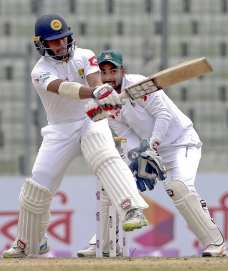 Sri Lankan batsman Kusal Mendis, left, bats during the first day of the second and final cricket test against Bangladesh in Dhaka, Bangladesh, Thursday, Feb. 8, 2018. (AP Photo)