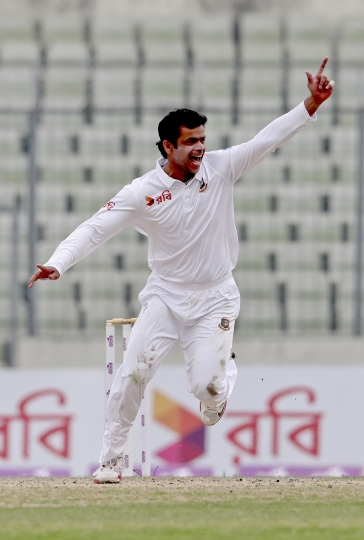 Bangladesh bowler Abdur Razzak, celebrates the wicket of Sri Lanka's Dinesh Chandimal during the first day of the second and final cricket test in Dhaka, Bangladesh, Thursday, Feb. 8, 2018. (AP Photo)