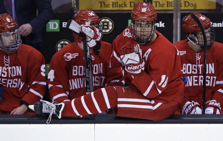In this Feb. 5, 2018, photo, Boston University forward Jordan Greenway sits on the boards as he waits for his line change against Harvard during the first period of the first round of the Beanpot hockey tournament in Boston, Monday, Feb. 5, 2018. The Boston University forward was preparing for his junior year last summer when he heard that USA Hockey might be calling on collegians and minor-league pros to fill out its Olympic roster. It was only after NHL players were officially ruled out and Greenway made the team that a reporter told him he would be the first African-American man on the U.S. Olympic team. (AP Photo/Charles Krupa)