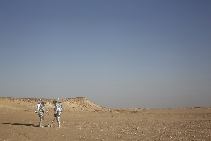 In this Feb. 7, 2018, photo, two scientists test space suits and a geo-radar for use in a future Mars mission in the Dhofar desert of southern Oman. The desolate desert in southern Oman resembles Mars so much that more than 200 scientists from 25 nations organized by the Austrian Space Forum are using it for the next four weeks to field-test technology for a manned mission to Mars. (AP Photo/Sam McNeil)
