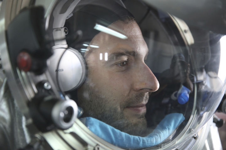 This Feb. 7, 2018, photo shows João Lousada, a flight controller for the International Space Station, wearing an experimental space suit during a simulation of a future Mars mission in the Dhofar desert of southern Oman. The desolate desert in southern Oman resembles Mars so much that more than 200 scientists from 25 nations organized by the Austrian Space Forum are using it for the next four weeks to field-test technology for a manned mission to Mars. (AP Photo/Sam McNeil)