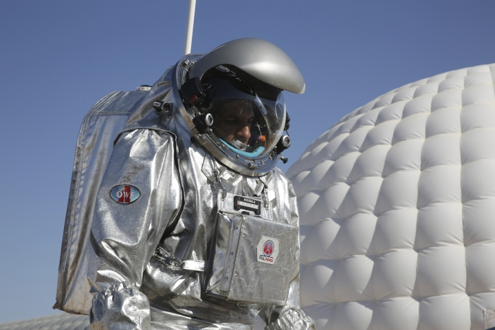 This Feb. 7, 2018, photo shows analog astronaut Kartik Kumar wearing an experimental space suit during a simulation of a future Mars mission in the Dhofar desert of southern Oman. The desolate desert in southern Oman resembles Mars so much that more than 200 scientists from 25 nations organized by the Austrian Space Forum are using it for the next four weeks to field-test technology for a manned mission to Mars. (AP Photo/Sam McNeil)