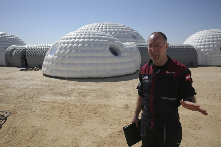 """This Feb. 7, 2018, photo shows Gernot Groemer, commander of the AMADEE-18 Mars simulation in the Dhofar desert of southern Oman. The desolate desert in southern Oman resembles Mars so much that more than 200 scientists from 25 nations organized by the Austrian Space Forum are using it for the next four weeks to field-test technology for a manned mission to Mars. Groeme, a veteran of 11 other simulations, said that: """"No matter who is going to this grandest voyage of our society yet to come, I think a few things we learn here will be actually implemented in those missions."""" (AP Photo/Sam McNeil)"""