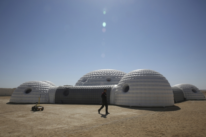 This Feb. 7, 2018, photo shows a 2.4-ton inflated habitat used by the AMADEE-18 Mars simulation in the Dhofar desert of southern Oman. The desolate desert in southern Oman resembles Mars so much that more than 200 scientists from 25 nations organized by the Austrian Space Forum are using it for the next four weeks to field-test technology for a manned mission to Mars. (AP Photo/Sam McNeil)