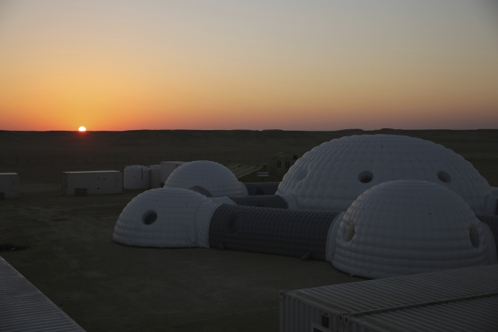 The sun rises over a 2.4-ton inflated habitat used by the AMADEE-18 Mars simulation in the Dhofar desert of southern Oman on Thursday, Feb. 8, 2018. The desolate desert in southern Oman resembles Mars so much that more than 200 scientists from 25 nations organized by the Austrian Space Forum are using it for the next four weeks to field-test technology for a manned mission to Mars. (AP Photo/Sam McNeil)