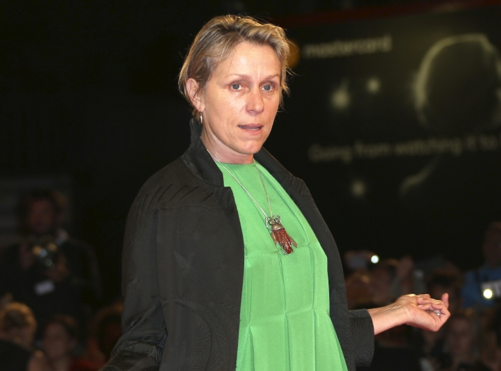 """FILE - In this Sept. 4, 2017 file photo, actress Frances McDormand poses for photographers at the premiere of ''Three Billboards Outside Ebbing Missouri', during the 74th edition of the Venice Film Festival in Venice, Italy. McDormand admits she's getting tired of collecting trophies for """"Three Billboards,"""" but she made sure to pick up one more award from a group near to her heart. The Oscar nominee accepted best actress at the ninth African-American Film Critics Association Awards. (Photo by Joel Ryan/Invision/AP, File)"""