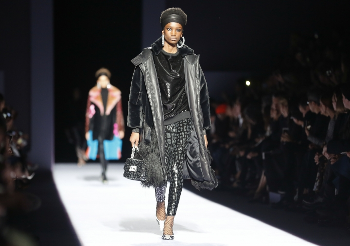 Fashion from Tom Ford is modeled during Fashion Week, Thursday Feb. 8, 2018, in New York. (AP Photo/Bebeto Matthews)