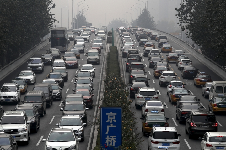 FILE - In this Oct. 26, 2017, file photo, motorists are clogged with heavy traffic on a city ring road in Beijing. An industry group, the China Association of Automobile Manufacturers, said Friday, Feb. 9, 2018 sales of sedans, SUVs and minivans rose 10.7 percent from a year earlier to 2.4 million. Total vehicle sales including trucks and buses rose 13.6 percent to 2.7 million. (AP Photo/Andy Wong, File)