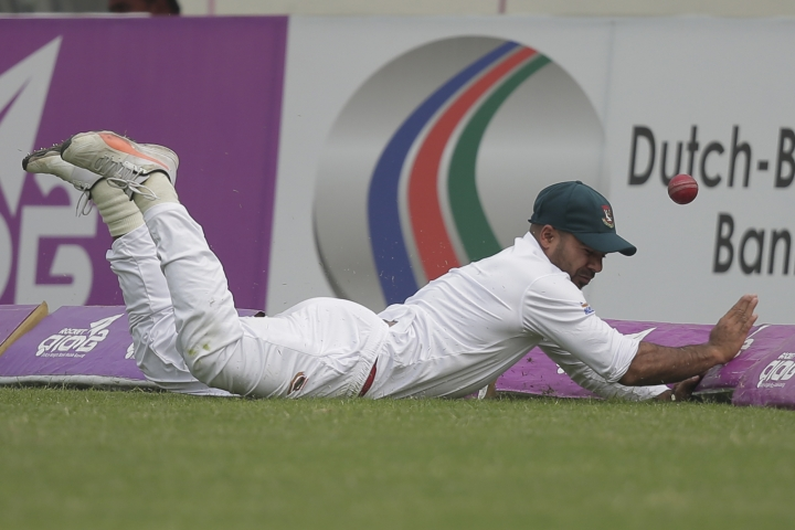 Bangladesh's Tanbir Hayder drives to stop the ball as he fields against Sri Lanka during the second day of the second and final test cricket match in Dhaka, Bangladesh, Friday, Feb. 9, 2018. (AP Photo/A.M. Ahad)