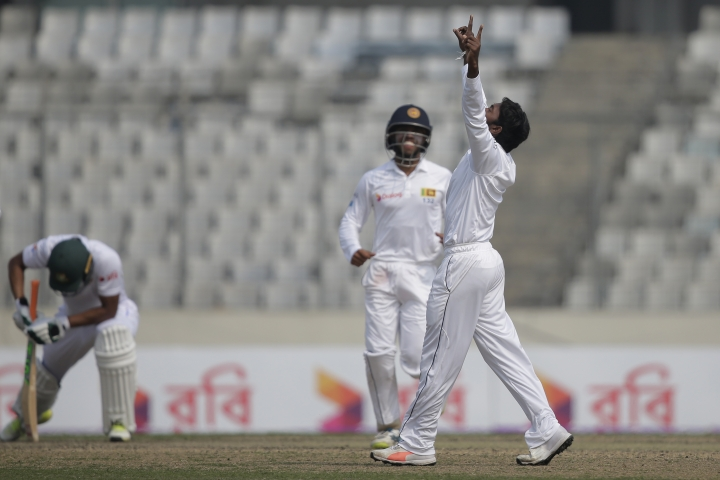 Sri Lanka's Akila Dananjaya, right, celebrates the dismissal of Bangladesh's captain Mahmudullah, left, during the second day of the second and final test cricket match in Dhaka, Bangladesh, Friday, Feb. 9, 2018. (AP Photo/A.M. Ahad)