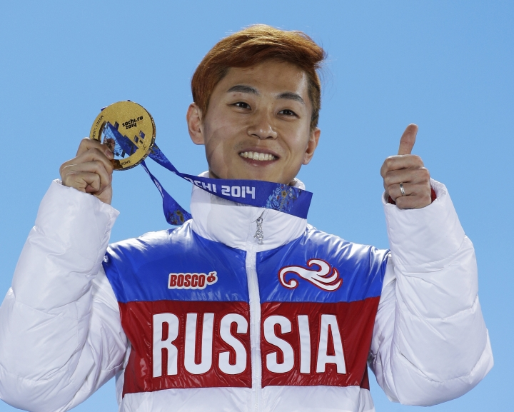 FILE - In this Feb. 15, 2014, file photo, men's 1,000-meter short track speedskating gold medalist Viktor Ahn, of Russia, gestures while holding his medal during the medals ceremony at the Winter Olympics in Sochi, Russia. Sports' highest court rejected appeals by all 45 Russian athletes plus two coaches who were banned from the Pyeongchang Olympics over doping concerns in a decision announced Friday, Feb. 9, 2018, less than nine hours before the opening ceremony. Among those excluded are six-time gold medalist Ahn, the short track speedskater whose return to his native South Korea for the Olympics had been hotly anticipated by local fans. (AP Photo/David J. Phillip, File)