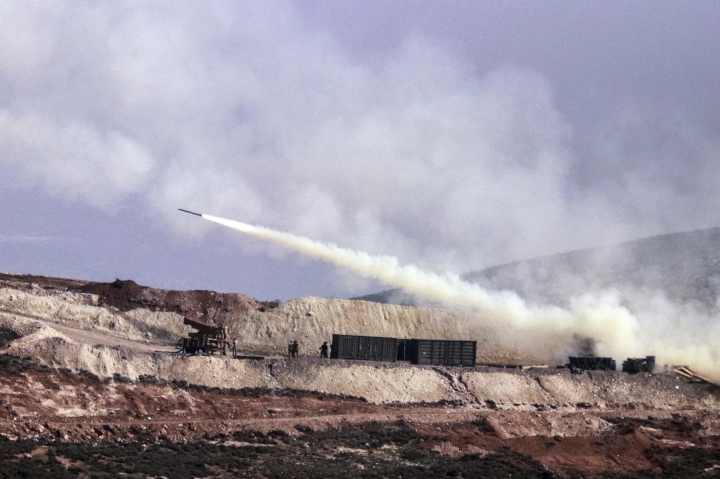 Turkish artillery fires toward Syrian Kurdish positions in Afrin area, Syria, from Turkish side of the border in Hatay, Turkey, Friday, Feb. 9, 2018. Turkish jets have resumed airstrikes in the Syrian Kurdish-run enclave of Afrin after a brief lull killing and wounding several people, the military and media reports said Friday.(AP Photo)