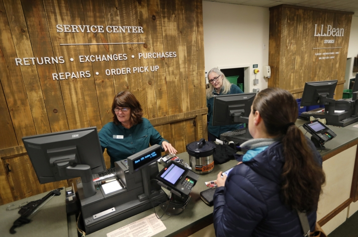 In this Friday, Feb. 2, 2018, photo Dawn Segars accepts a customer's returned items at the LL Bean retail store in Freeport, Maine. L.L. Bean's generous return policy is going to be a little less forgiving: The company, which has touted its 100 percent satisfaction guarantee for more than a century, is imposing a one-year limit on most returns to reduce growing abuse and fraud. (AP Photo/Robert F. Bukaty)