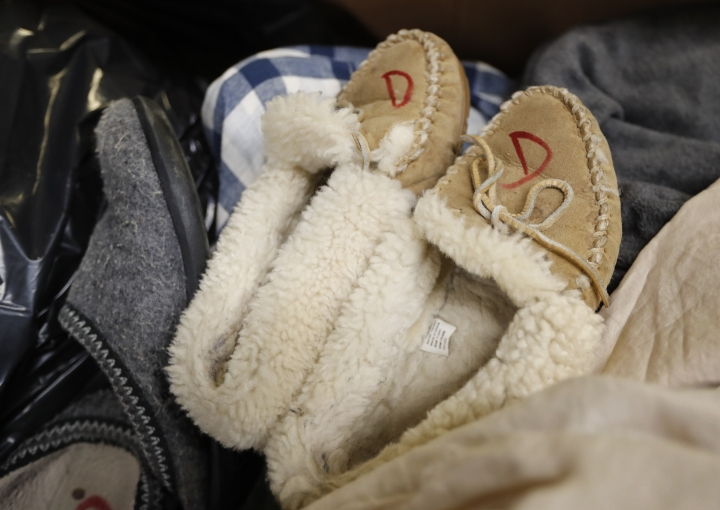 In this Friday, Feb. 2, 2018 photo slippers that were returned to the L.L. Bean retail store in Freeport, Maine are marked to prevent future returns. Much of L.L. Bean's returns are donated to Goodwill. L.L. Bean's generous return policy is going to be a little less forgiving: The company, which has touted its 100 percent satisfaction guarantee for more than a century, is imposing a one-year limit on most returns to reduce growing abuse and fraud. (AP Photo/Robert F. Bukaty)