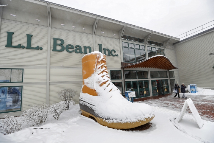 In this Friday, Feb. 2, 2018 photo customers leave the LL Bean retail store in Freeport, Maine. The outdoor retailer is imposing a one-year limit on most returns to reduce growing abuse and fraud. (AP Photo/Robert F. Bukaty)