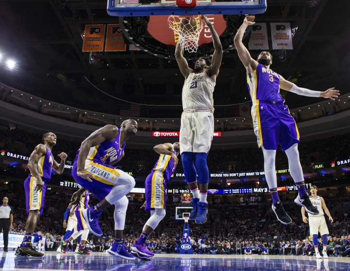Philadelphia 76ers' Joel Embiid, center, of Cameroon, dunks after getting past New Orleans Pelicans' Nikola Mirotic, right, of Montenegro, during the first half of an NBA basketball game, Friday, Feb. 9, 2018, in Philadelphia. (AP Photo/Chris Szagola)
