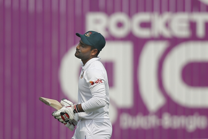 Bangladesh's Imrul Kayes reacts as he walks back to the pavilion after his dismissal by Sri Lanka's Rangana Herath during the third day of the second and final test cricket match in Dhaka, Bangladesh, Saturday, Feb. 10, 2018. (AP Photo/A.M. Ahad)