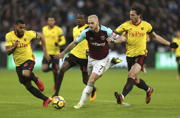 West Ham's Marko Arnautovic, middle, battles for the ball during the Premier League soccer match between West Ham United and Watford at the London Stadium, London, England. Saturday Feb. 10, 2018. (Steven Paston/PA via AP)