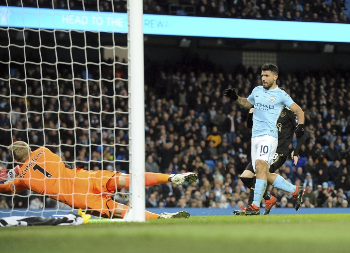 Manchester City's Sergio Aguero, right, scores his side's second goal during the English Premier League soccer match between Manchester City and Leicester City at the Etihad Stadium in Manchester, England, Saturday, Feb. 10, 2018. (AP Photo/Rui Vieira)