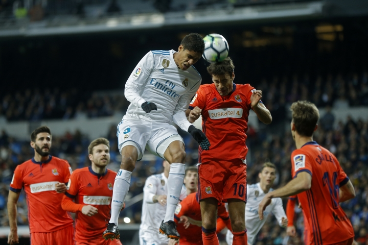 Real Madrid's Varane, top left, goes for a header with Real Sociedad's Xabi Prieto during a Spanish La Liga soccer match between Real Madrid and Real Sociedad at the Santiago Bernabeu stadium in Madrid, Saturday, Feb. 10, 2018. (AP Photo/Francisco Seco)