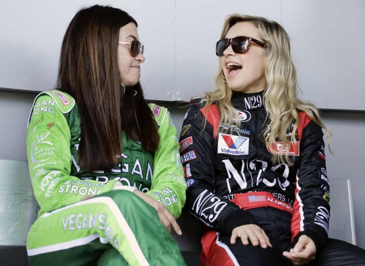 Leilani Munter, left, and pole sitter Natalie Decker, right, share a laugh before the start of the ARCA auto race at Daytona International Speedway, Saturday, Feb. 10, 2018, in Daytona Beach, Fla. (AP Photo/Terry Renna)