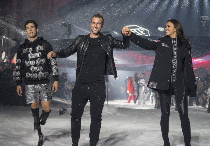 Designer Philipp Plein, center, greets attendees after the show featuring his collection during Fashion Week in New York, Saturday, Feb. 10, 2018. (AP Photo/Craig Ruttle)