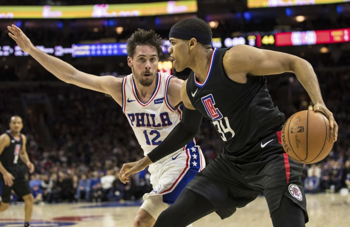 Los Angeles Clippers' Tobias Harris, right, looks to make his move against Philadelphia 76ers' T.J. McConnell, left, during the first half of an NBA basketball game, Saturday, Feb. 10, 2018, in Philadelphia. (AP Photo/Chris Szagola)
