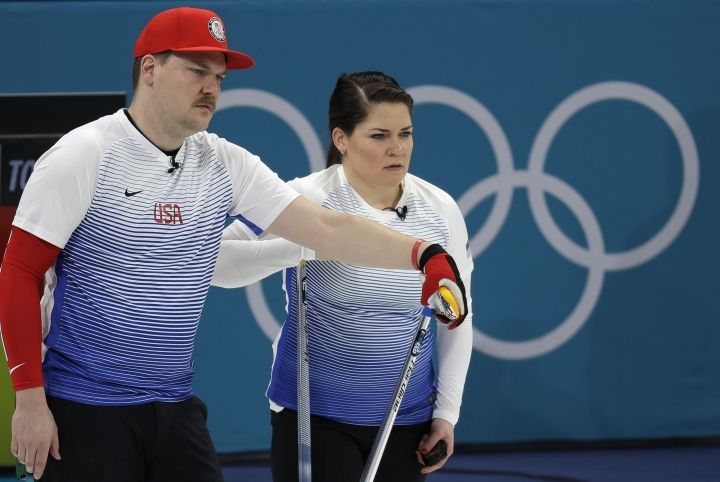 United States' siblings Matt and Becca Hamilton for their turn during the mixed doubles curling match against Finland at the 2018 Winter Olympics in Gangneung, South Korea, Sunday, Feb. 11, 2018. (AP Photo/Aaron Favila)