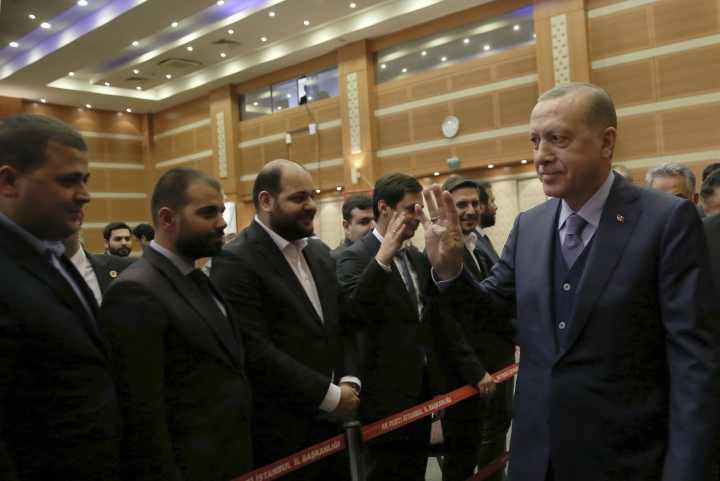 "Turkey's President and leader of ruling Justice and Development Party Recep Tayyip Erdogan arrives to address the party members in Istanbul, Saturday, Feb. 10, 2018. Erdogan has announced that a Turkish military helicopter has been ""downed"" Saturday in northern Syria during Ankara's offensive on Syrian Kurdish militia there.( Murat Cetinmuhurdar/Pool Photo via AP )"