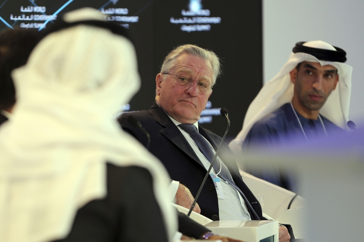 """American Hollywood star Robert De Niro listens to one of the panel speakers next to Dr. Thani Ahmed Al Zeyoudi, right, the UAE Minister of Climate Change and Environment during the World Government Summit in Dubai, United Arab Emirates, Sunday, Feb. 11, 2018. De Niro took aim at the Trump administration's stance on climate change, telling a packed audience that he was visiting from a """"backward"""" country suffering from """"temporary insanity."""" (AP Photo/Kamran Jebreili)"""