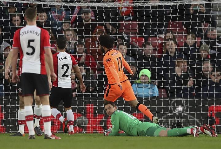 Liverpool's Mohamed Salah scores against Southampton during the English Premier League soccer match at St Mary's Stadium, Southampton, England, Sunday Feb. 11, 2018. (John Walton/PA via AP)