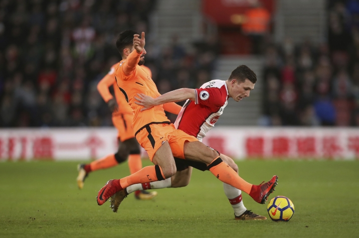 Southampton's Pierre-Emile Hojbjerg and Liverpool's Emre Can battle for the ball during the English Premier League soccer match at St Mary's Stadium, Southampton, England, Sunday Feb. 11, 2018. (John Walton/PA via AP)