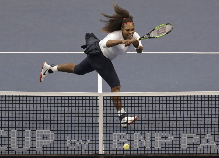 USA's Serena Williams returns a shot against Netherlands' during a doubles match in the first round of Fed Cup tennis competition in Asheville, N.C., Sunday, Feb. 11, 2018. (AP Photo/Chuck Burton)