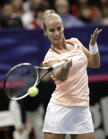 Netherlands' Richel Hogenkamp returns a shot against USA's Venus Williams during a match in the first round of Fed Cup tennis competition in Asheville, N.C., Sunday, Feb. 11, 2018. (AP Photo/Chuck Burton)