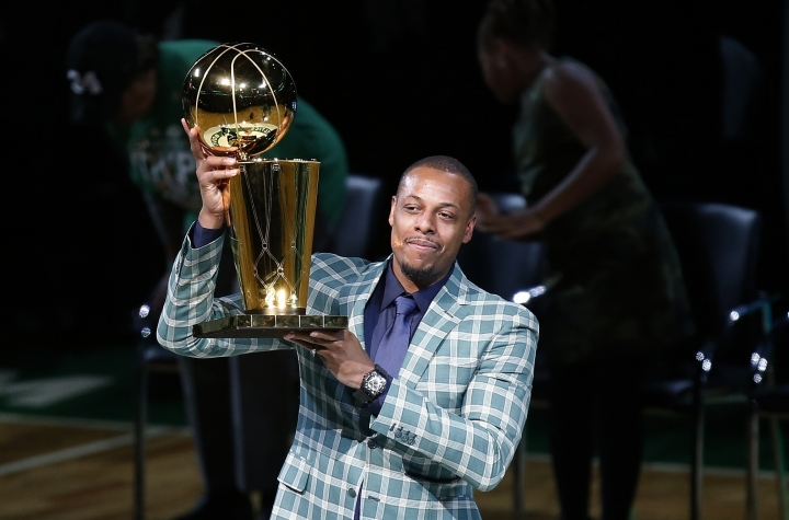 Former Boston Celtics Paul Pierce holds the NBA championship trophy that he won with the team during a ceremony to retire his number following a basketball game against the Cleveland Cavaliers in Boston, Sunday, Feb. 11, 2018. (AP Photo/Michael Dwyer)